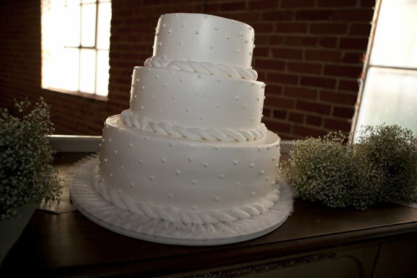 white-polka-dot-wedding-cake